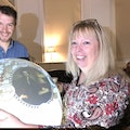 Professor Val Gibson and Dr Harry Cliff with the Voyage of Discovery globe