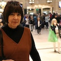Pattie Moore retracing her steps in Grand Central Station New York, where earlier in her career, she would dress as an 80 year old to explore the impact of the city and public space design on older people.