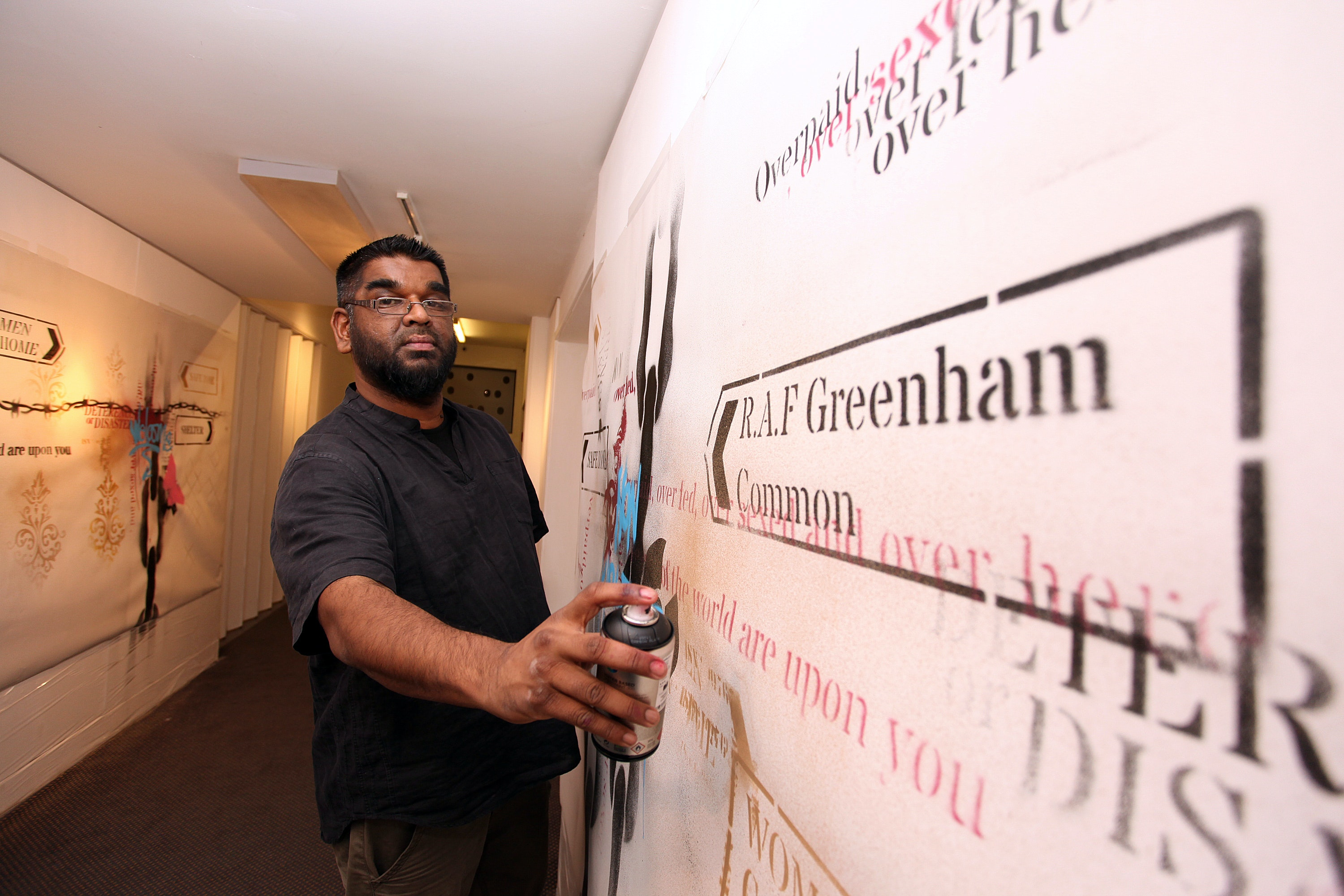 Street artist Mohammed Ali working with the design team